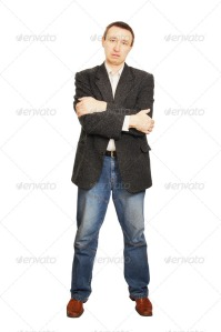 Man in a jacket and dark blue jeans crossed his hands on a breast