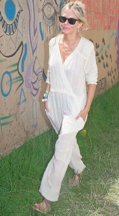 sienna miller at glastonbury wearing white linen jumpsuit
